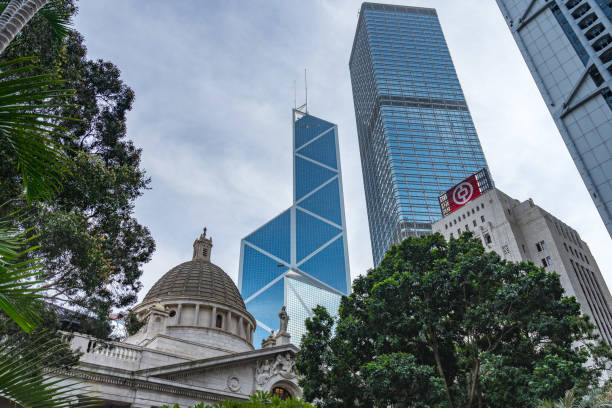 Dome of Legislative Council Building with Bank of China building behind it, Hong Kong Dome of Legislative Council Building with Bank of China building behind it. Hong Kong, Central, January 2018 bank of china stock pictures, royalty-free photos & images