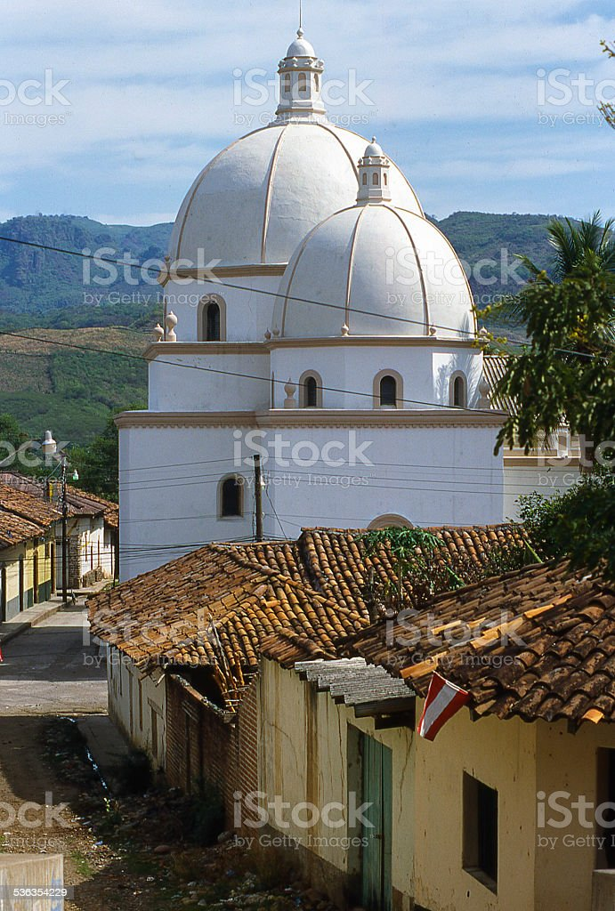 Dome of the Cathedral and cobble-stone streets Pespire Honduras stock photo