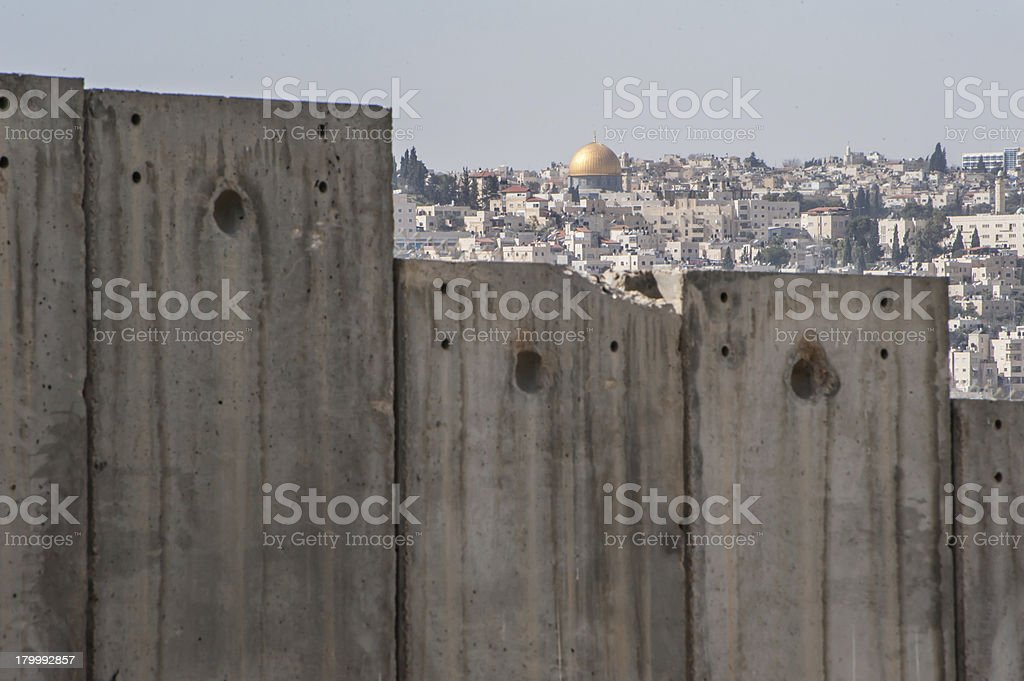 Dome of the Rock and Israeli separation wall stock photo