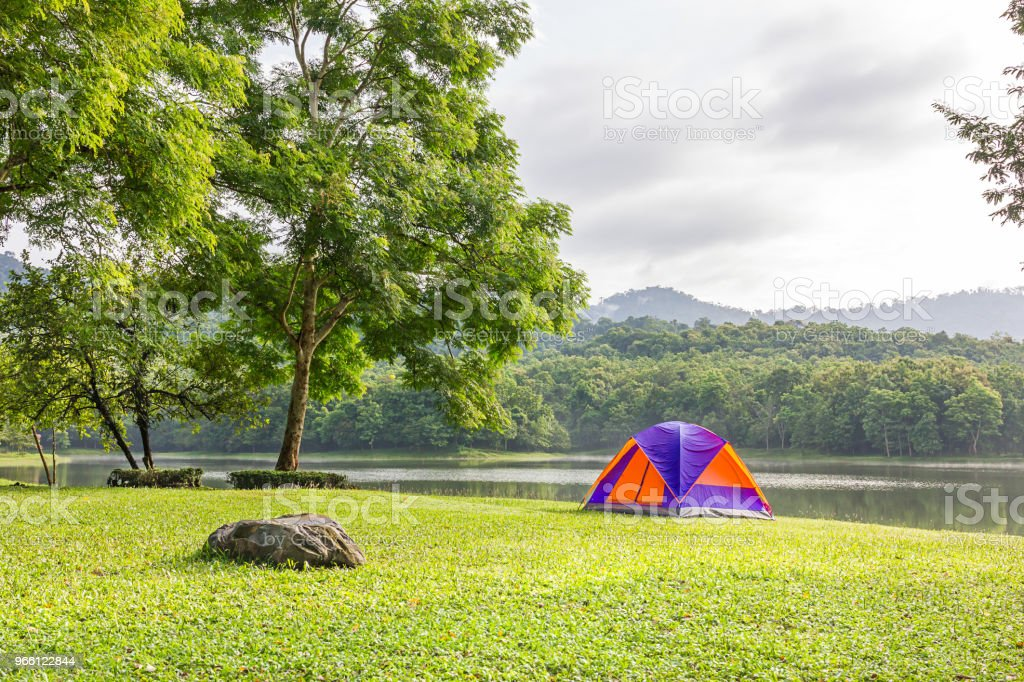 Dome tent camping at lake side - Royalty-free Adventure Stock Photo