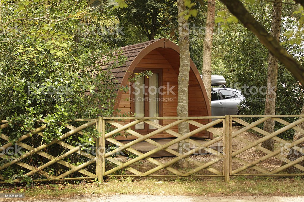 Domed wooden cabin on a camp site. royalty-free stock photo