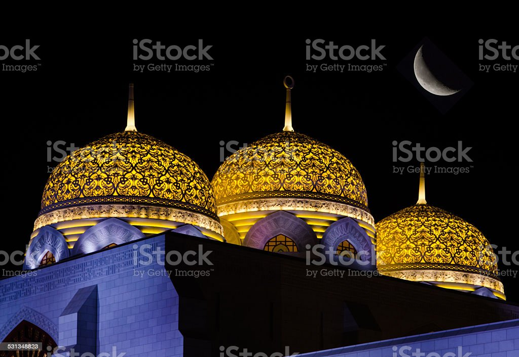 Domes at mosque with moon stock photo