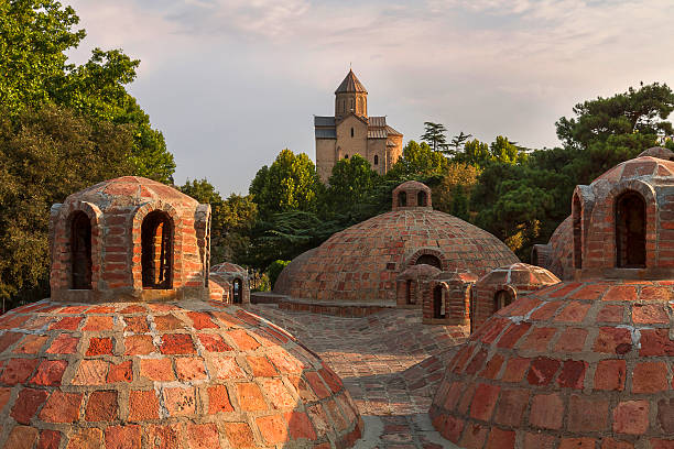 domes of a thermal bath in tbilisi, georgia - zolfo foto e immagini stock