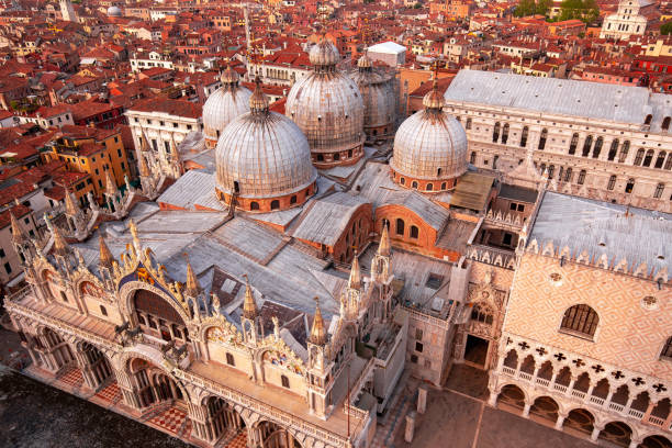 Domes of St. Mark's Basilica, Venice, Italy aerial view of Saint Mark's Basilica and city roofs, Venice, Italy basilica stock pictures, royalty-free photos & images
