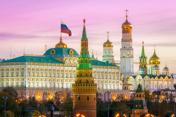 Domes of the Moscow Kremlin Domes of the Moscow Kremlin in the morning kremlin stock pictures, royalty-free photos & images