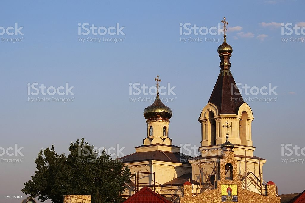 Domes with crosses of Orthodox church at sunset royalty-free stock photo