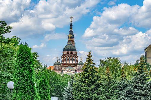 istock Domes with crosses of the Annunciation Cathedral in Kharkiv (Ukraine) against a blue cloudy sky 1265469418