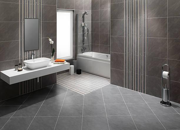 domestic badezimmer - fliesenboden stock-fotos und bilder