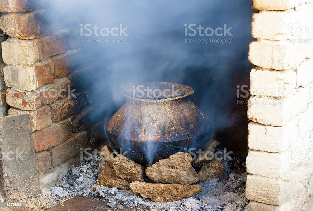 Domestic Boiling using cow dung stock photo