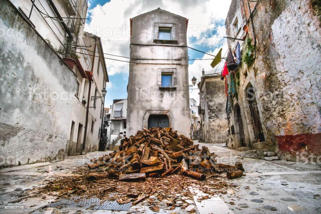 domestic heating firewood old in south italy village Vico del Gargano in Apulia stock photo