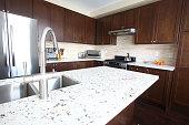 Domestic kitchen with quartz countertops and chestnut cabinets