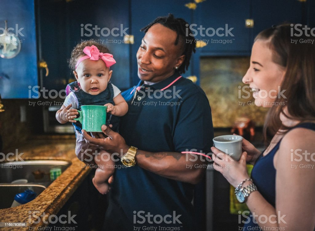 Domestic candid home life with a mixed race family, father is African...