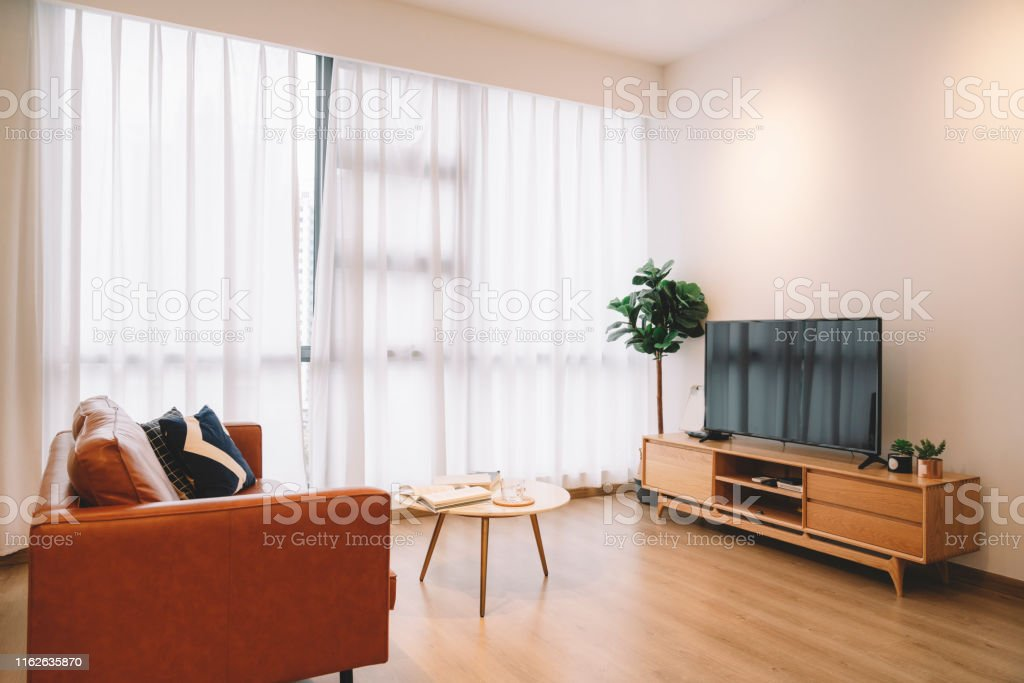 Domestic Living Room Of A Condominium With Led Tv Sofa And Coffee