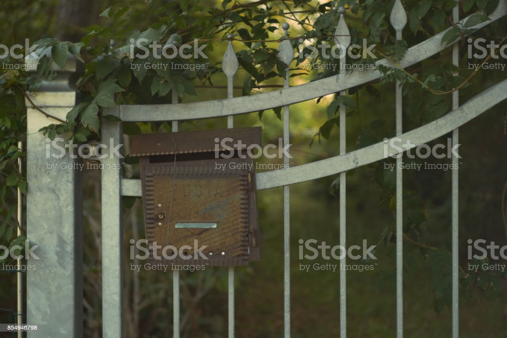 domestic mailbox on a metal gate stock photo