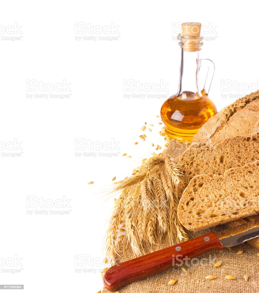 Domestic rye bread ears and oil stock photo