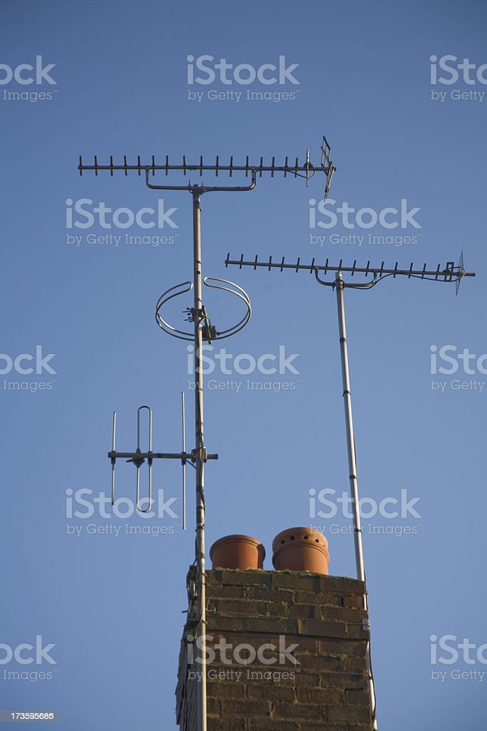 Domestic TV and Radio Aerials attached to Chimney royalty-free stock photo