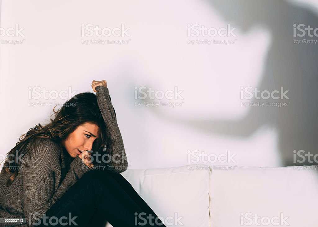 Domestic violence against women stock photo