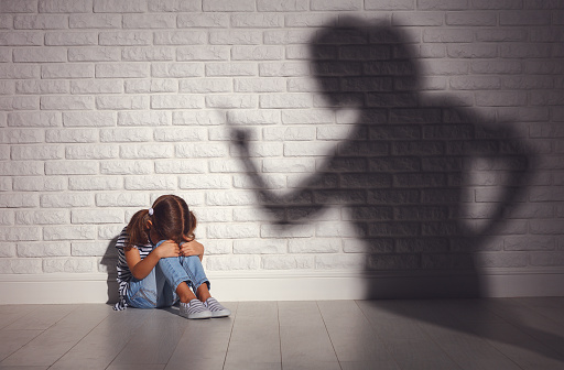 istock domestic violence. angry mother scolds   frightened daughter 917505716