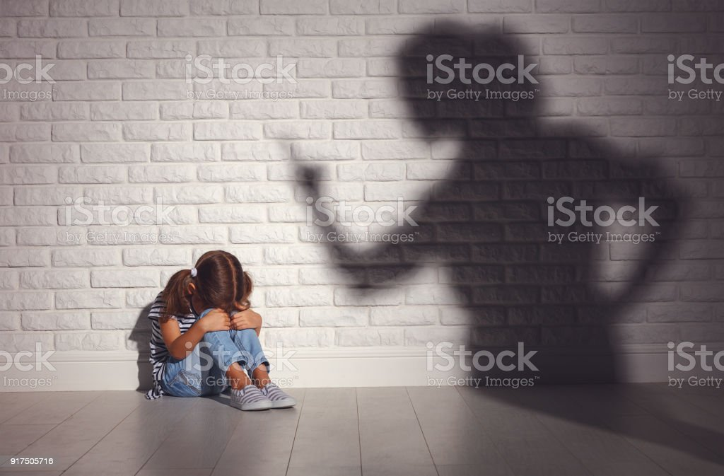 domestic violence. angry mother scolds   frightened daughter stock photo