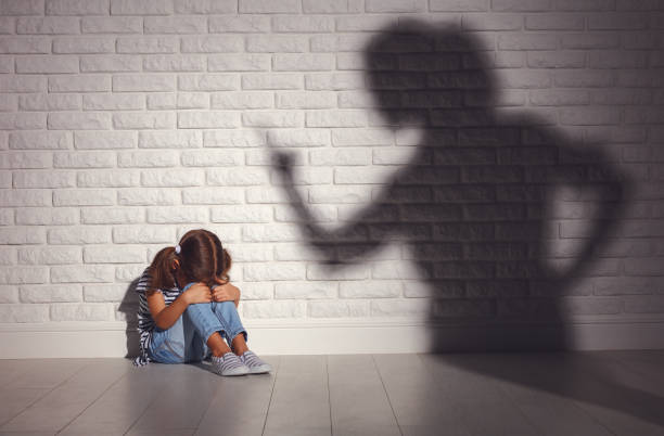 domestic violence. angry mother scolds   frightened daughter domestic violence. angry mother scolds   frightened daughter sitting on floor abuse stock pictures, royalty-free photos & images