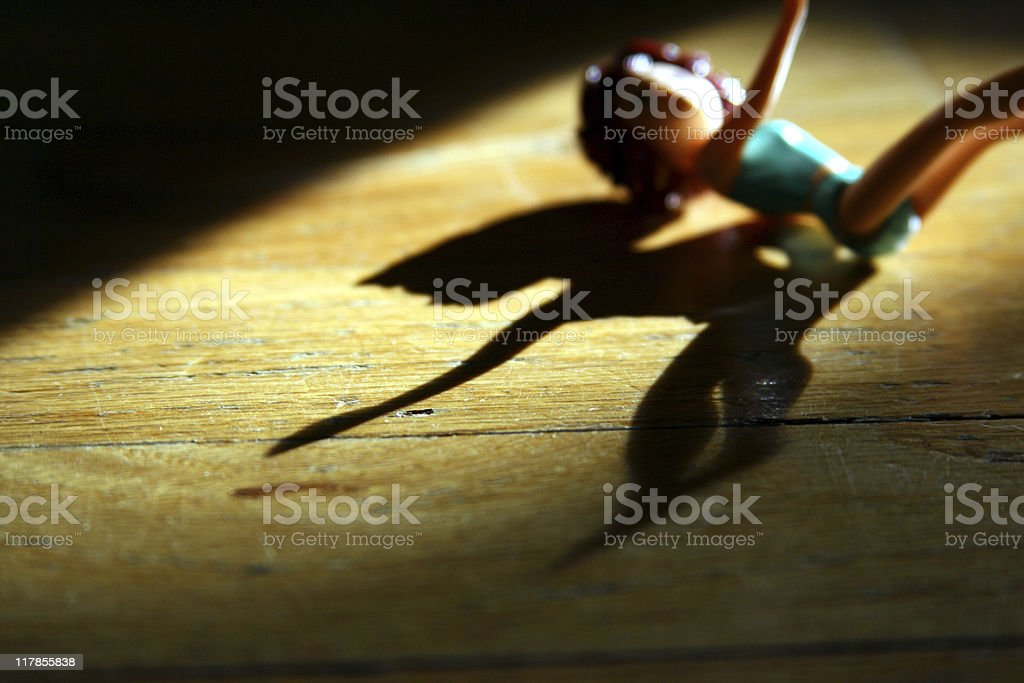 Domestic Violence Concept Female Doll Reaching for Help stock photo