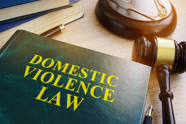domestic violence law on a wooden table. - domestic violence stock pictures, royalty-free photos & images