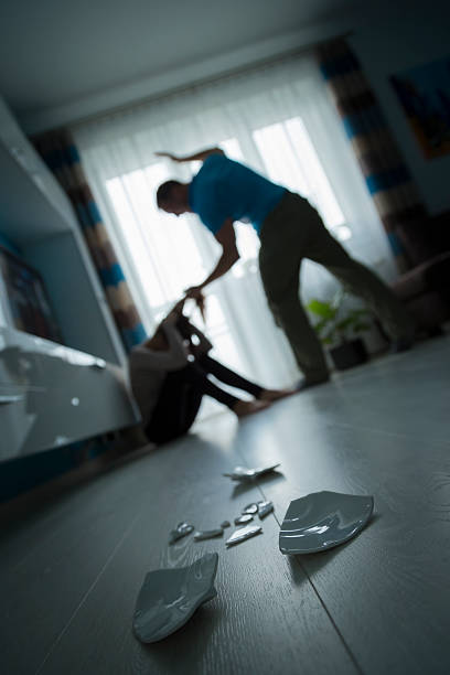 Domestic violence Man beating the woman on the floor abuse stock pictures, royalty-free photos & images
