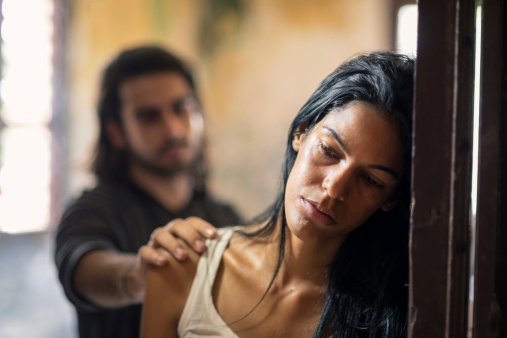 istock domestic violence with young man and abused woman 149015591