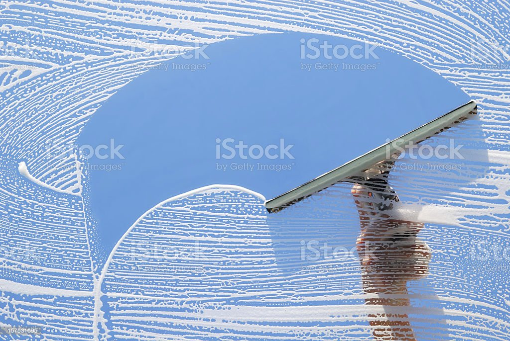 Domestic Window Cleaner washing stock photo