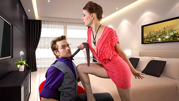 dominating girlfriend seducing her boyfriend - man dominating woman stock photos and pictures
