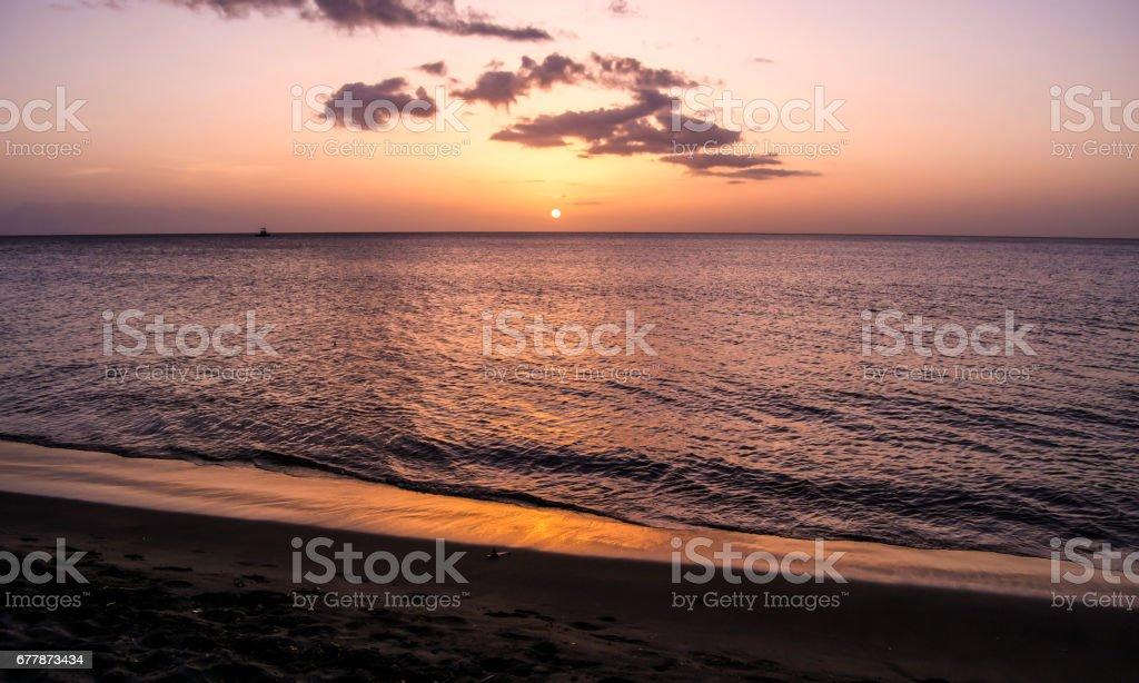 Dominica Island Sunset over Caribbean Sea stock photo