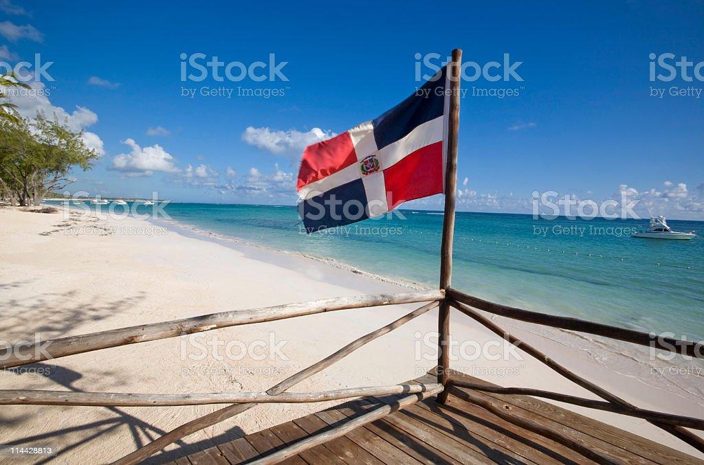Dominican republic flag in the beach stock photo