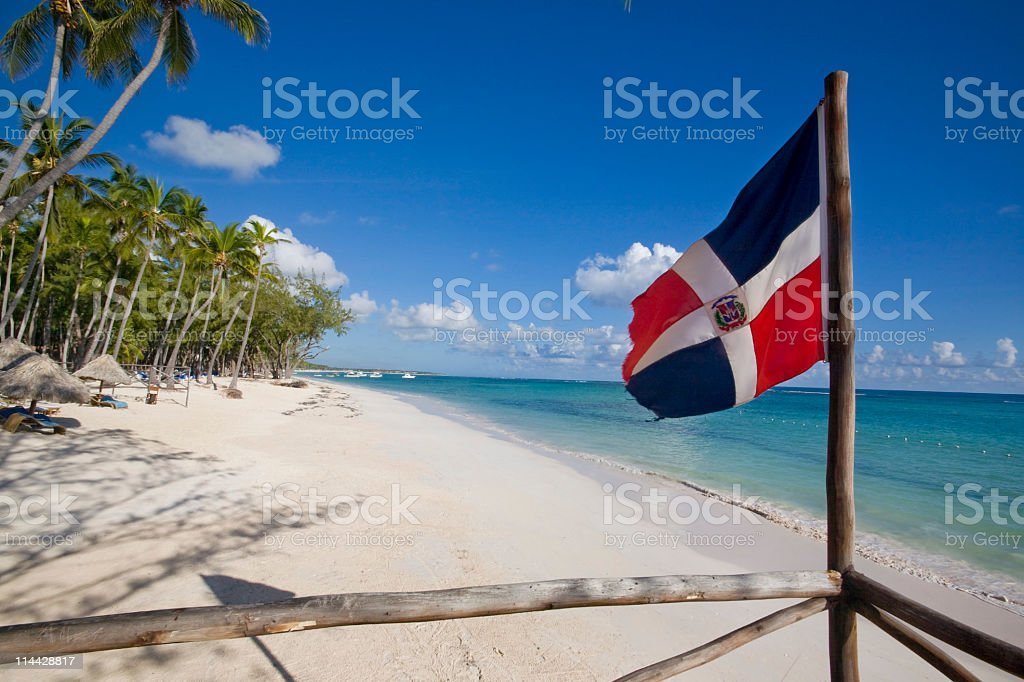 Dominican republic flag in the beach stock photo
