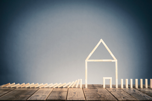 istock Domino block and residential image 695485450