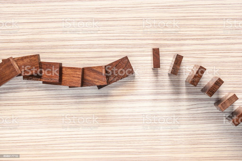 Domino effect concept stock photo