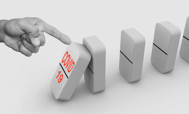 Domino effect, hand finger starting chain reaction. stock photo