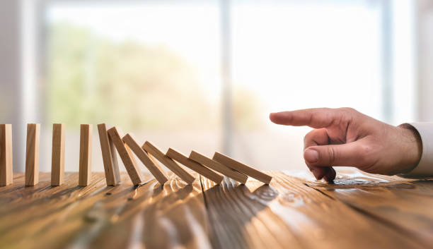 Domino Effect. Just Starting or Triggering Multi Effective Business Process stock photo