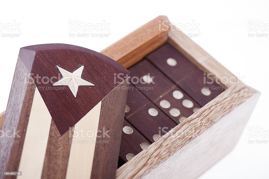 Domino in wooden box with Cuba's flag on white background royalty-free stock photo