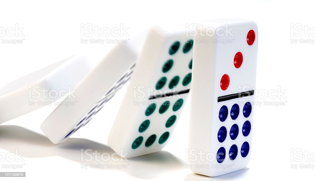Dominoes falling against each other on a white background royalty-free stock photo