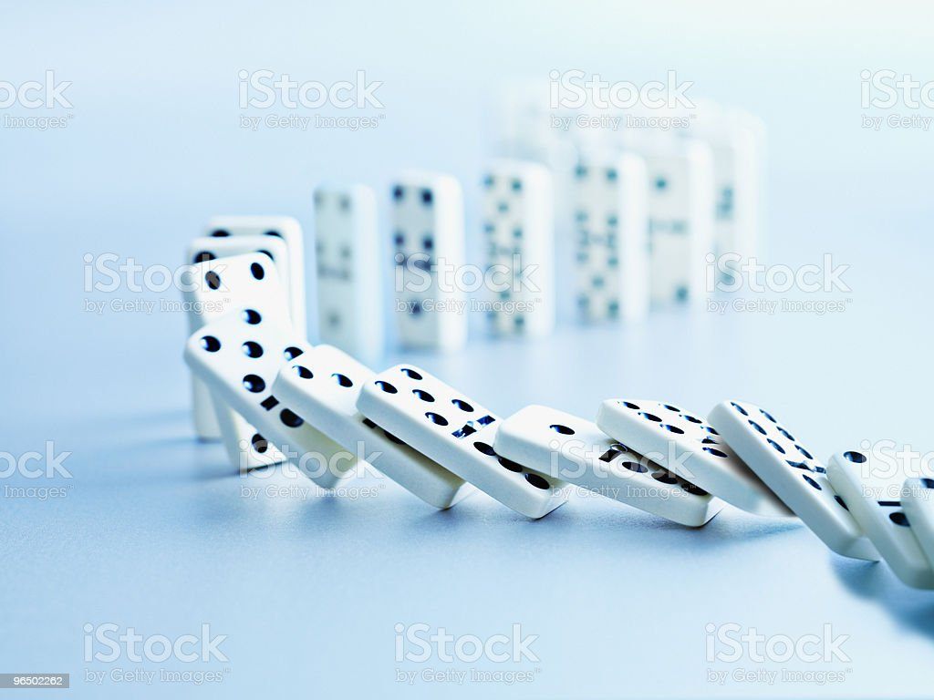Dominoes falling in a row  Anticipation Stock Photo