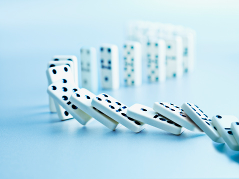 Dominoes Falling In A Row Stock Photo - Download Image Now