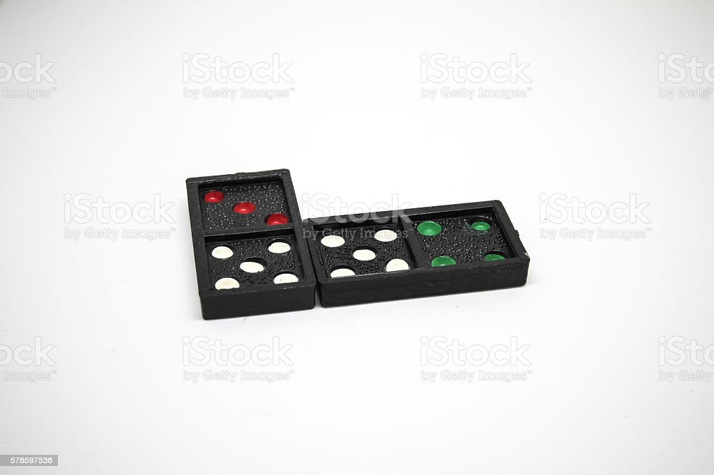 Dominoes is a game played with rectangular 'domino' tiles. stock photo