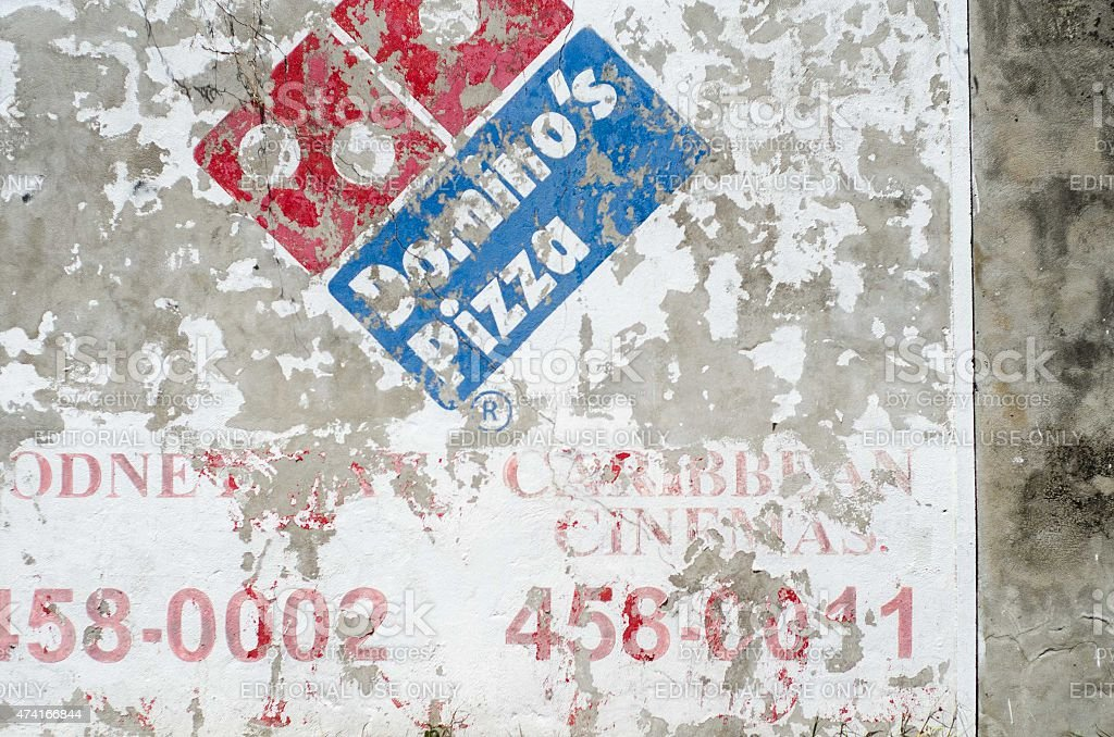 domino's Pizza advertisement sign on wall stock photo