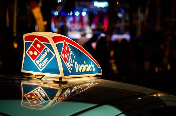 Dominos Pizza car illuminated sign stock photo