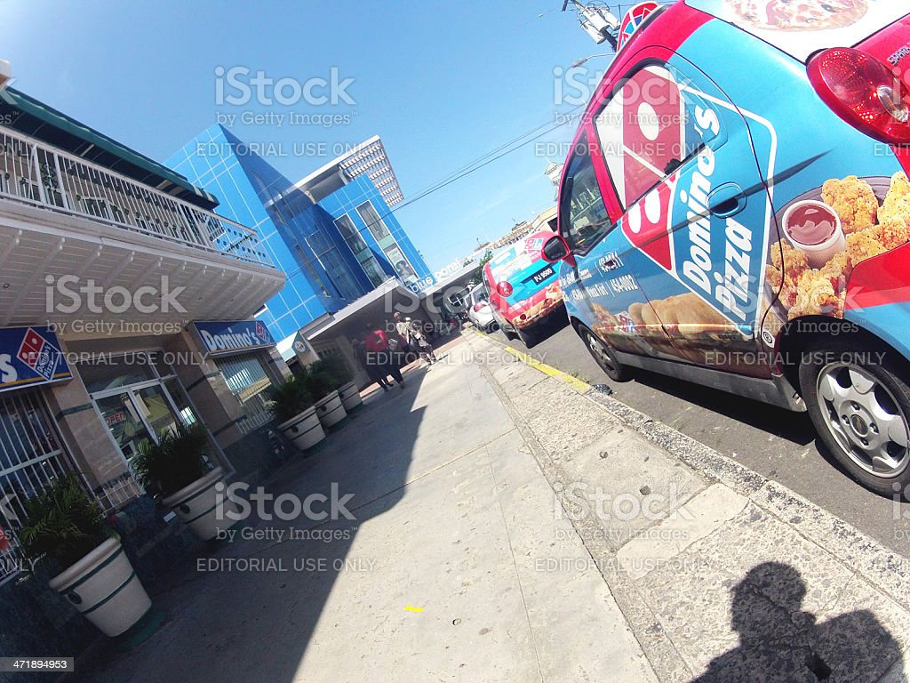 Domino's Pizza vehicle parked near business stock photo