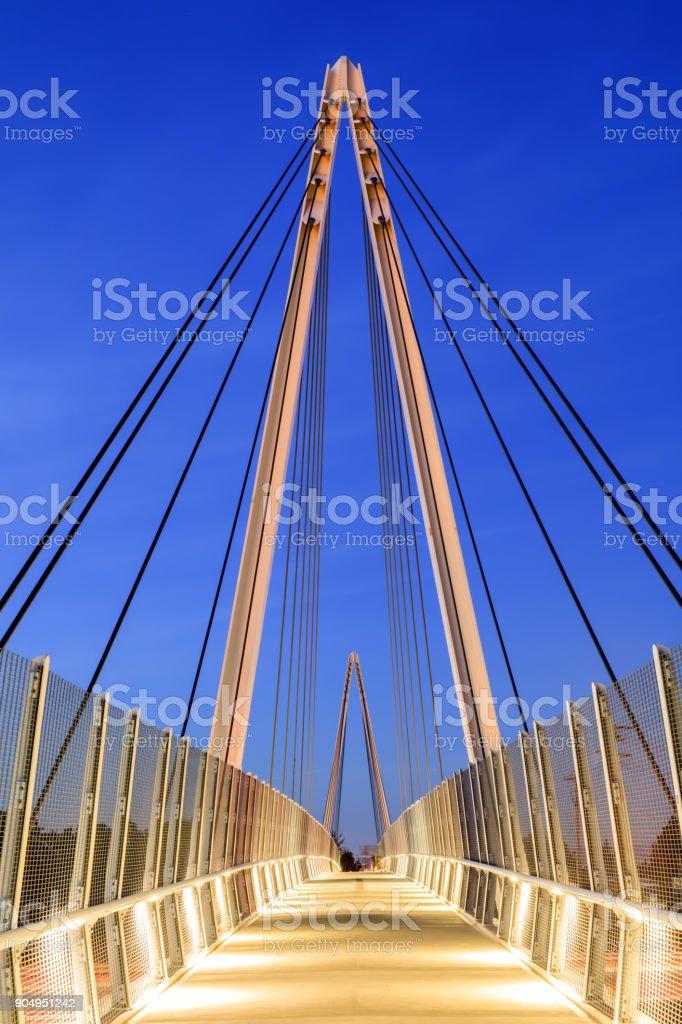 Don Burnett Bicycle-Pedestrian Bridge (aka Mary Avenue Bicycle Footbridge) on a clear winter evening. stock photo