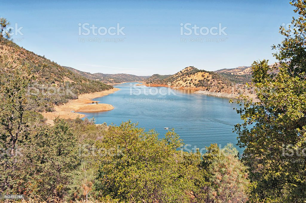 Don Pedro Lake from above with Boat stock photo