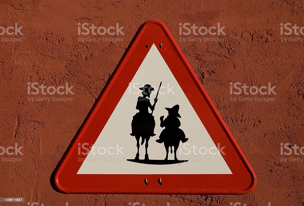 Don Quijote and Sancho Panza silhouette in Traffic Sing stock photo
