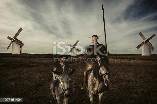 istock Don Quixote and Sancho panza riding through fields in La Mancha Spain 1007161404