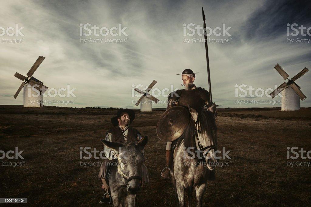 Don Quixote and Sancho panza riding through fields in La Mancha Spain stock photo